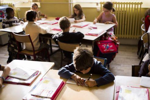 Les enseignants grévistes estiment que Paris n'a pas les moyens de mettre en œuvre une réforme de qualité. Crédits photo : FRED DUFOUR/AFP