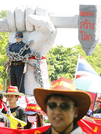 Thai workers march on International Labor Day in Bangkok