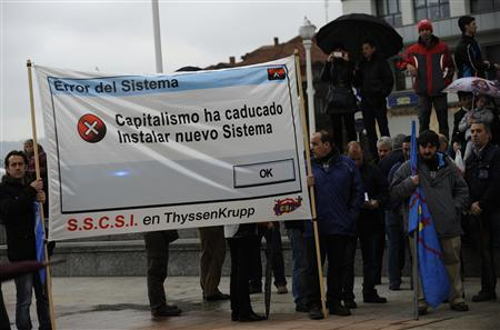 People take part in a May Day demonstration in Gijon
