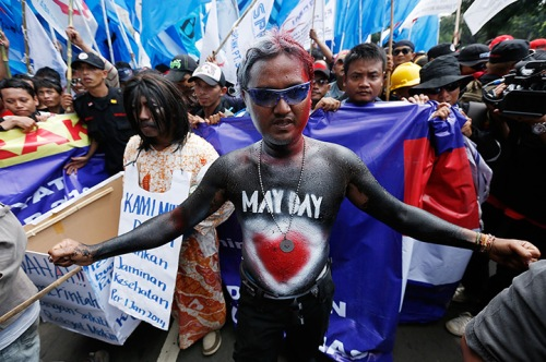 A May Day demonstrator in bodypaint in Jakarta