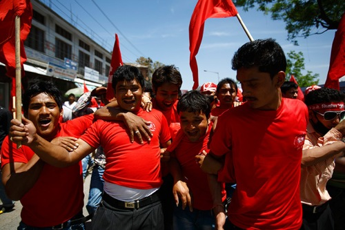 Maoist) activists and supporters cheer their party in Kathmandu
