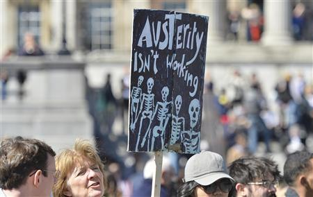 A protester holds a placard during a rally in Trafalgar Square in central London