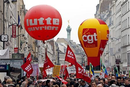 Thousands of demonstrators march in the annual May Day demonstrations in downtown Paris