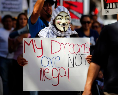 Immigration reform supporter wears a Guy Fawkes mask as he takes part in a May Day demonstration in San Diego, California