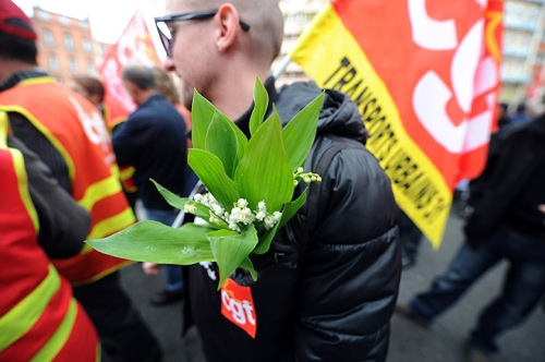 A man holding a sprig of Lily of the Valley in Toulouse