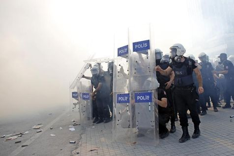 526455-turkish-riot-police-take-position-during-a-protest-at-taksim-square-in-istanbul