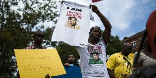 """Marche en mémoire de Trayvon Martin et pour un"""" justice équitable"""", dans le quartier de Harlem, à New York, dimanche 21 juillet 2013. Eduardo Munoz / REUTERS"""