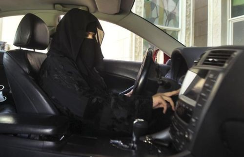 601896-a-woman-drives-a-car-in-saudi-arabia