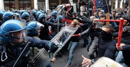 Clashes between demonstrators and police during the march for the International Labor Day in Turin