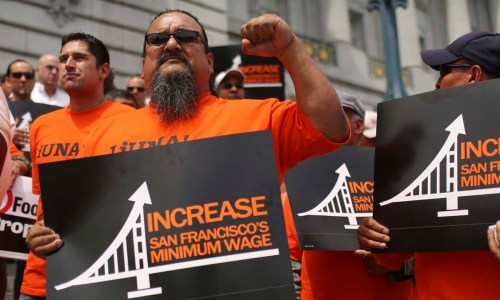 Workers gather at City Hall to listen to speeches during an International Worker's Day rally in San Francisco