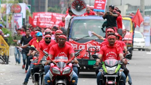 Protesters riding motorcycles take part in a Labour Day rally in Dhaka