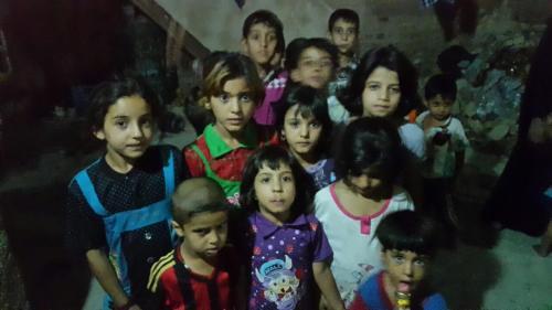 Enfants réfugiés dans un foyer de l'OLFI à Kerbala