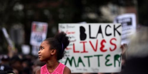 A New York, lors de la manifestation organisée à la mémoire d'Eric Garner.   AFP/Yana Paskova