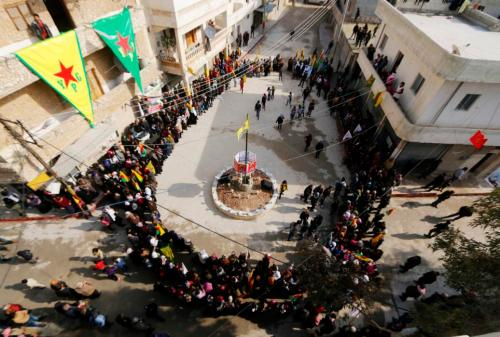 Kurdish civilians gather in celebration after it was reported that Kurdish forces took control of Syrian town of Kobani, in Sheikh Maksoud neighborhood of Aleppo