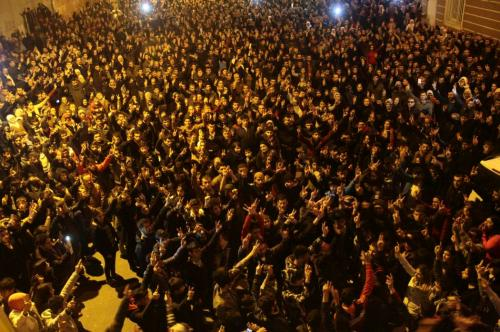 People celebrate in Kurdish-dominated Diyarbakir in southeastern Turkey, after Kurdish forces took full control of the Syrian town of Kobani
