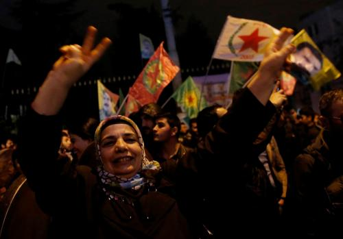 Pro-Kurdish demonstrators celebrate in central Istanbul, after Kurdish forces took full control of the Syrian town of Kobani