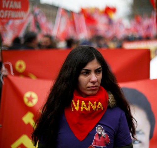 A woman takes part in a commemoration parade in Duisburg