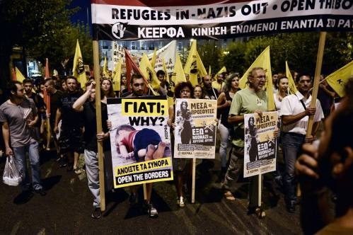"People holding posters, including one showing drowned Syrian toddler Aylan Kurdi, march towards the EU offices in central Athens during a rally in support of migrants and refugees as part of the European Day of Action on September 12, 2015. Tens of thousands of Europeans rallied urging solidarity with the huge numbers of refugees entering the continent, as Hungary's populist premier said leaders were ""in a dream world"" about the dangers posed by the influx. AFP PHOTO / LOUISA GOULIAMAKI"