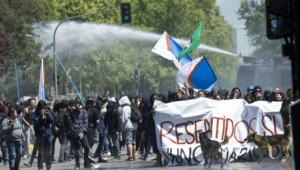 Chili-des-milliers-d-etudiants-manifestent-contre-la-reforme-de-l-education_article_popin