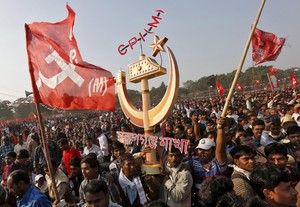 KOLKATA, DEC 27 -- Supporters of Communist Party of India (Marxist), CPI (M), carry a replica of their party symbol during a rally in Kolkata on Friday. Thousands of CPI (M) supporters and its leaders gathered on the first day of their four-day long plenum in Kolkata on Sunday. REUTERS/UNI PHOTO-15R