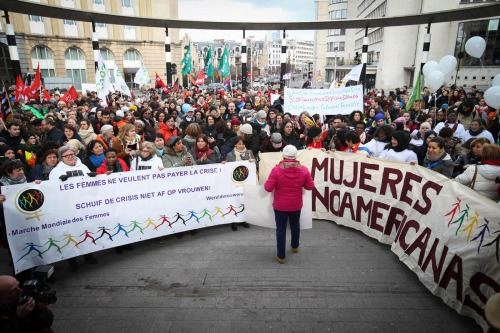 "People hold a banner which translates as ""Women don't want to pay for the crisis"" during the World March of Women 2016 in Brussels on March 8, 2016 as part of the International Women's Day. This year's edition of the international feminist campaign is demanding quality shelter for female asylum seekers. / AFP / Belga / VIRGINIE LEFOUR / Belgium OUTVIRGINIE LEFOUR/AFP/Getty Images ** OUTS - ELSENT, FPG, CM - OUTS * NM, PH, VA if sourced by CT, LA or MoD **"