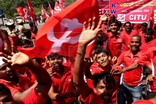 epa05285188 Indian labours and members of different trade unions dance to the local tune  during International Labour Day rally in Bangalore, India, 01 May 2016. Labour Day or May Day is observed all over the world on the first day of the May to celebrate the economic and social achievements of workers and fight for labourers rights.  EPA/JAGADEESH NV