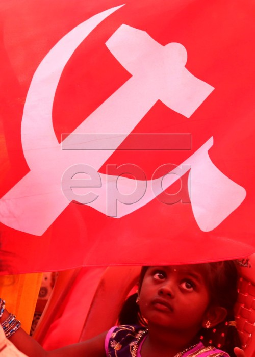 epa05285245 An Indian young girl hold a flag at a rally during International Labour Day in Bangalore, India, 01 May 2016. Labour Day or May Day is observed all over the world on the first day of the May to celebrate the economic and social achievements of workers and fight for labourers rights.  EPA/JAGADEESH NV