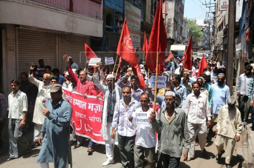 epa05285247 Communist Party of India (CPI) activists take out a rally on the occasion of International Labour Day, in Bhopal, India, 01 May 2016. Labour Day or May Day is observed all over the world on the first day of the May to celebrate the economic and social achievements of workers and fight for labourers rights.  EPA/SANJEEV GUPTA