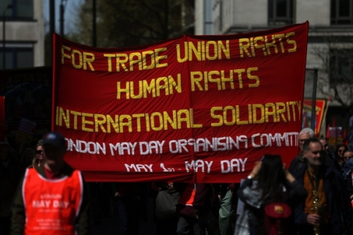 Demonstrators march in a May Day rally in London on May 1, 2016. / AFP PHOTO / JUSTIN TALLIS