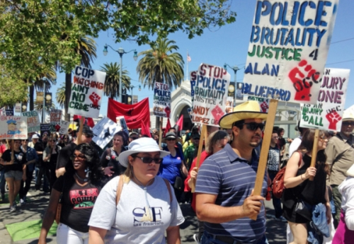 Marchers in San Francisco rally in support of immigrant and workers' rights and to demand justice for several men fatally shot by city police during May Day demonstrations Sunday, May 1, 2016. It's one of several events in cities nationwide to call for better wages for workers, an end to deportations and support for an Obama administration plan to give work permits to immigrants in the country illegally whose children are American citizens.(AP Photo/Olga Rodriguez)