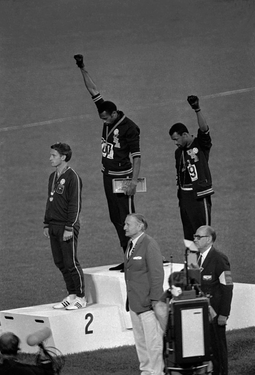 old and Carlos the bronze for the 200-meter run at the Summer Olympic Games in Mexico City. Australia's silver medalist Peter Norman is at left. When Tommie Smith bowed his head and thrust a black-gloved fist toward the sky from the top of the Olympic podium 45 years ago, he was making a personal statement about human rights. With questions swirling over an anti-gay law in Russia, which will host the Winter Games in Sochi in February, today's athletes face a similar choice, Smith told The Associated Press Sunday, Sept. 8, 2013, at a track and field meet in Rieti, Italy. (AP Photo/File)/NY152/717491874698/AN OCT. 16, 1968, B&W FILE PHOTO; /1309091753